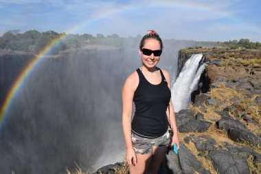 Standing on the edge of Victoria Falls, Zambia